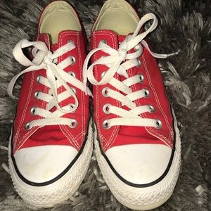 Red low top Chuck Taylor's